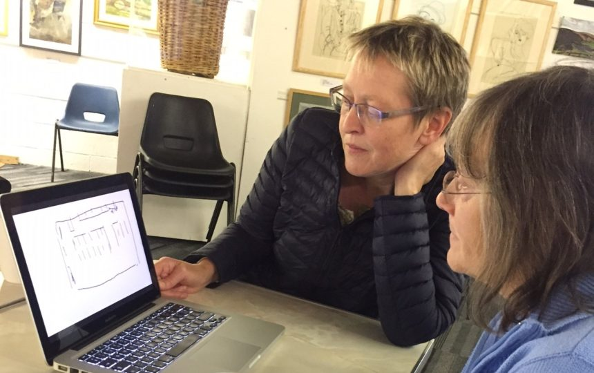 Two women working on an art and oral history film making